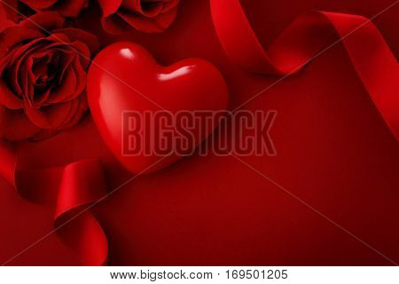 Valentine red heart, roses and ribbon. Valentine's Day decoration. greeting card with copy space