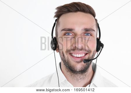 Young handsome technical support dispatcher, isolated on white