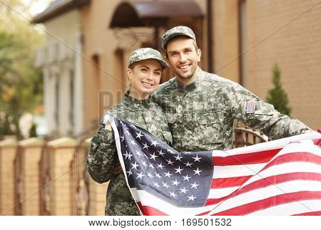 Military couple reunited  on a sunny day