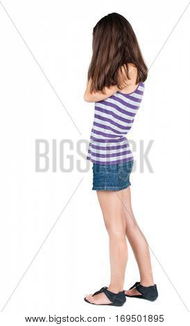 Back view of shocked woman in blue jeans dress. girl hid his eyes behind his hands.  Rear view people collection.  backside view of person.  Isolated over white background.