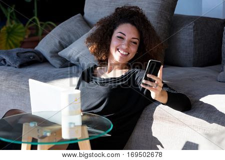 Girl Smiling Looking At Smartphone