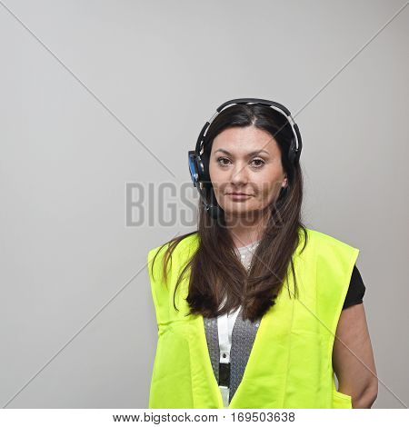 Woman With Wireless Picking System Control and Safety Vest