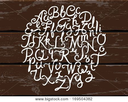 Handwritten alphabet vector font. Hand drawn brush script letters on the old painted wood panels background. Stock vector lettering typography