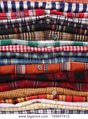Shirts stack on shelf