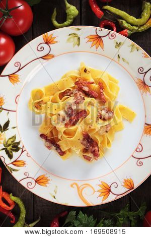 Italian pasta carbonara, pappardelle with pancetta bacon, egg and cheese sauce