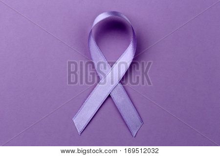 Lavender ribbon on color background. Cancer and epilepsy concept