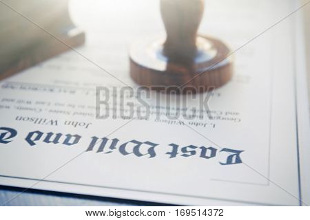 Modern notarial stamp on old document, closeup