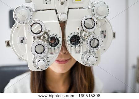Young woman doing eye test