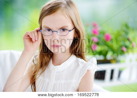 Moody Little Girl Wearing Eyeglasses Feeling Angry And Unsatisfied