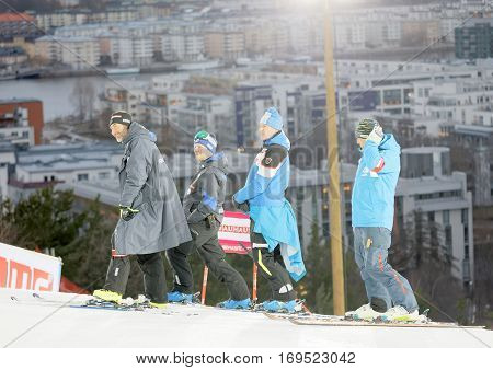 STOCKHOLM SWEDEN - JAN 31 2017: Smilng officials inspecting the ski used for parallel slalom at the Alpine Audi FIS Ski World Cup. January 31 2017 Stockholm Sweden