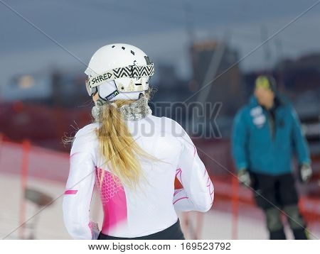 STOCKHOLM SWEDEN - JAN 31 2017: Rear view of Mikaela Shiffrin inspecting the ski used for parallel slalom at the Alpine Audi FIS Ski World Cup. January 31 2017 Stockholm Sweden