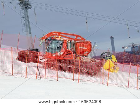 STOCKHOLM SWEDEN - JAN 31 2017: Piste caterpillar preparing the ski used for parallel slalom at the Alpine Audi FIS Ski World Cup. January 31 2017 Stockholm Sweden