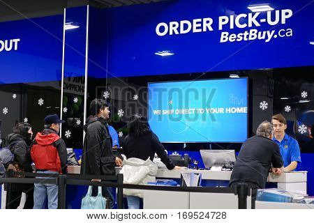 Coquitlam, BC, Canada - December 30, 2016 : Motion of people line up for buying gift inside Best buy store