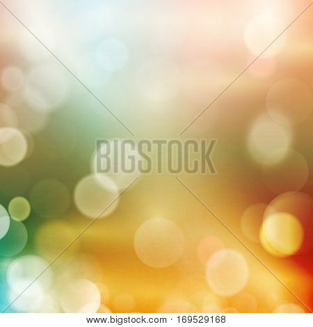 Abstract colourful blurred background in shades of reds, pinks, yellows, greens and blues with defocused light dots. Bokeh background