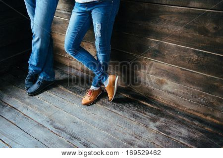 boy and girl feet in shoes waiting for a newborn baby.