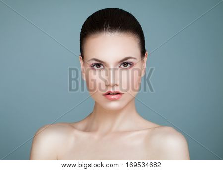 Spa Beauty. Young Woman with Healthy Skin on Blue Background. Aesthetic Medicine Healthcare and Cosmetology Concept