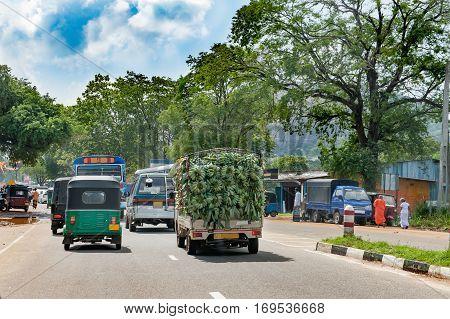 Sri Lankan small town street the car carrying crude bananas
