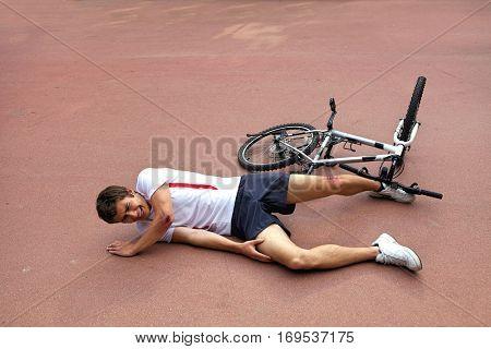 Young man injured during riding a bike