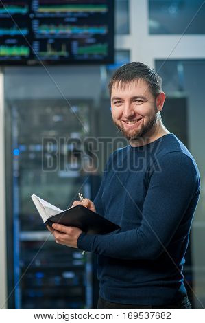 network engineer working in server room corporate business man working on tablet computer