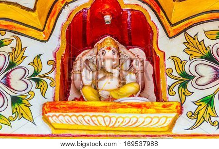 A deity of Ganesha the Hindu god of good luck above a temple door in Rajasthan.