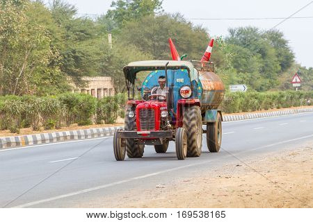 Rajasthan INDIA 21st January 2017 - A small tractor-tanker driving down the national highway.