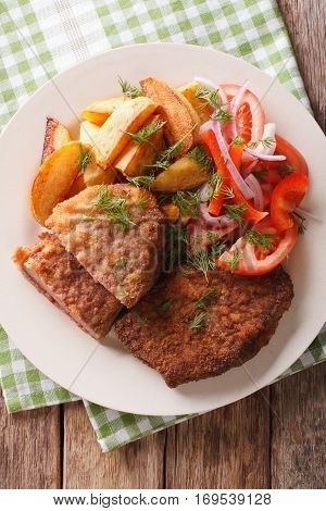Fried Breaded Rump Steak With Potato And Vegetables Close-up. Vertical Top View