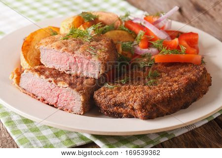 Fried Breaded Rump Steak With Potato And Vegetables Close-up. Horizontal