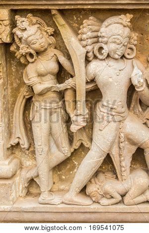 A Sculpture Of A Warrior And Nymphs In Abhaneri