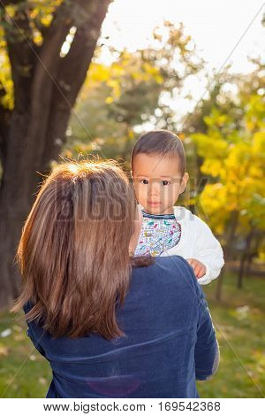 Asian Granny Playing With Her Grandson In The Park