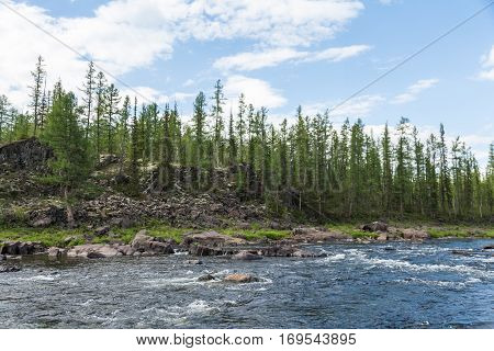 Beautiful cliffs and rapids on the river. Eastern Siberia. Krasnoyarsk territory.