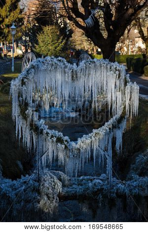 Icicle heart decoration in town park in austrian village