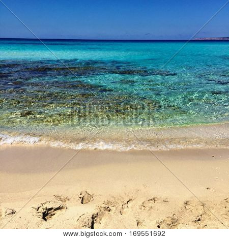 Beatiful Sunny Beach day in Formentera Spain in the middle of the holiday summer season.
