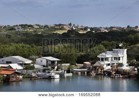 Houses near the water and on the hills of Willemstad on Curacao