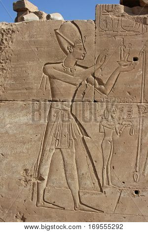 Pharoah sculture on a frieze wall in The Temple of Karnak Egypt 2008