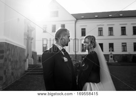 Bride Looks Proudly At A Stylish Fiance