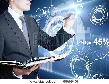 Concentrated caucasian businessman with open notepad drawing creative business charts and diagrams. Financial growth concept