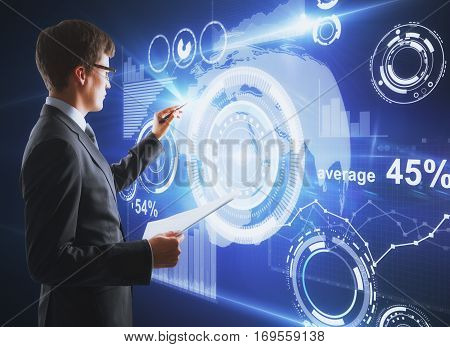 Focused caucasian businessman with open notepad drawing creative business charts and diagrams. Finance concept
