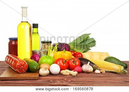 Fresh vegetables and foodstuff on white background
