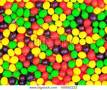 Multicolored candies for use as background. Closeup.