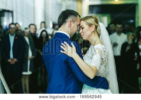 Pretty Bride Leans To A Groom While Dancing With Him At The First Time