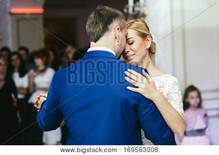 Bride And Groom Dance At The First Time With Closed Eyes