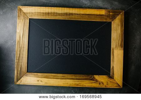 Beautiful Wooden frame mock-up on black background.