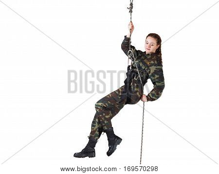 Girl soldier in training. Female soldiers hanging on the climbing equipment. Form camouflage. White background
