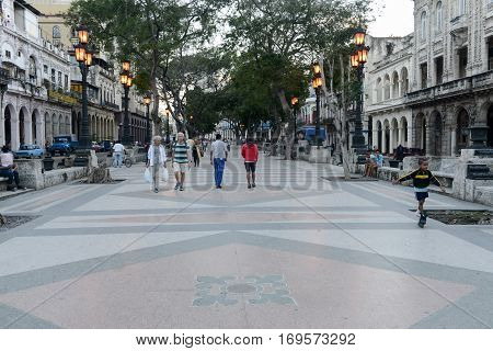 People Walking At The Famous Street Of Paseo Del Prado