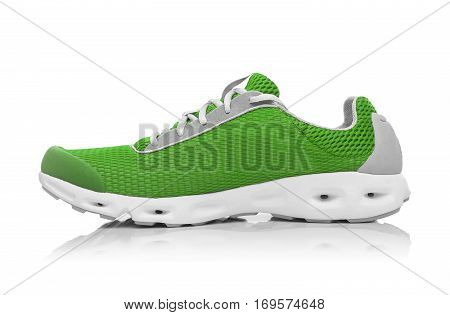 Unbranded modern sneaker isolated on a white background. Lime or green sneaker.