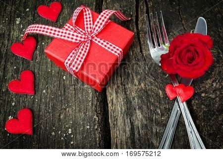Valentine's day gift heart and cutlery are on wood