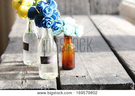Gracias label and nice flowers in the bottles, vintage style