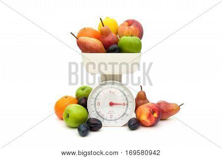 Fruit and kitchen scales isolated on white background. horizontal photo.