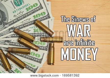 Bullet shells and dollars with message