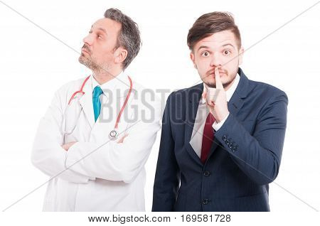 Young Businessman Doing Shus Or Quiet Gesture